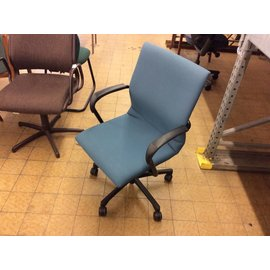 Light blue office chair on castors