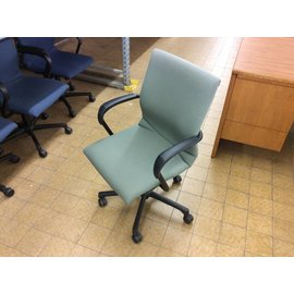 Green office chair on castors
