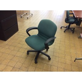 Dark green desk chair on castors
