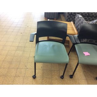 Green padded stacking chair on castors (8/30/18)