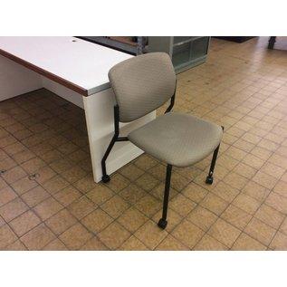 Tan padded side chair on castors (8/29/18)