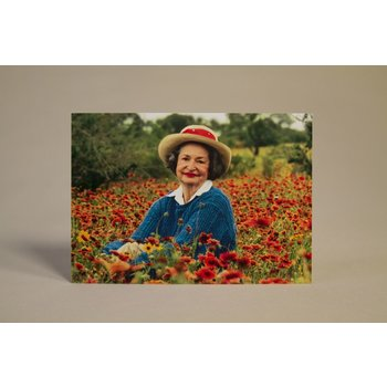 Lady Bird Full color postcard of Mrs. Johnson in a field of Texas wildflowers.