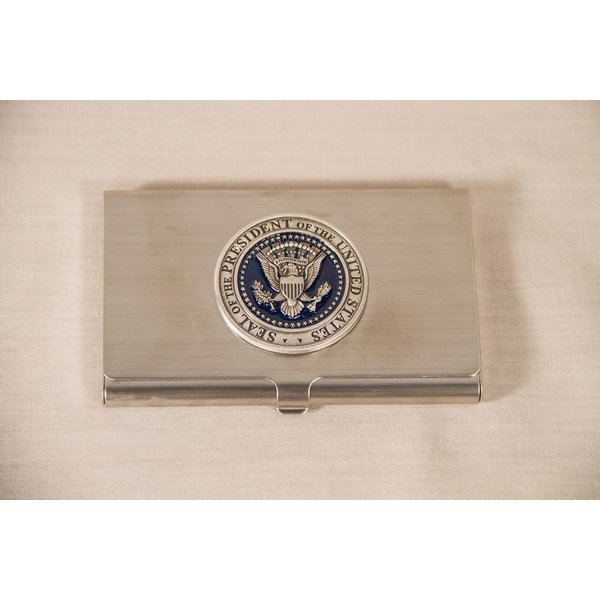 "Patriotic Presidential seal business card holder with pewter and navy enamel detail and a border which reads ""Seal of the President of the United States."""