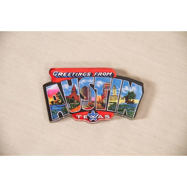 "Texas Traditions Vintage postcard style acrylic magnet that reads ""Greetings from Austin."""