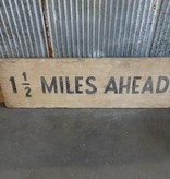 1.5 Miles ahead sign