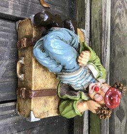 Clown Figure Lying On Suitcase