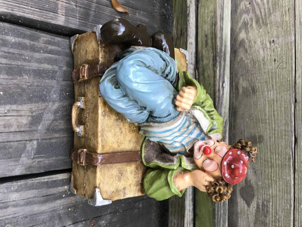 Clown Figure Lying On Suitcase