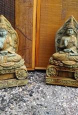 Small Buddha Sitting On Throne