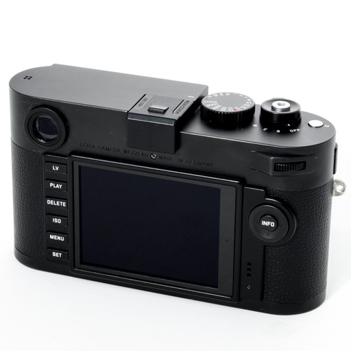 Used Monochrom w/ 2 Batteries, Battery Charger, Booklets, Box, and Strap