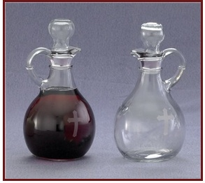 "Pair of cruets - 10 oz. bottles, Ht. 6"" w/ etched cross"