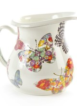 Mackenzie-Childs Let your kitchen take flight! Butterfly Garden Enamelware features a colorful flutter of hand-applied butterflies. Each one shows off a signature MacKenzie-Childs pattern as it flits about. Lidded pieces are topped with a knob. Just as much fun indoors as