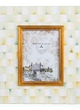Mackenzie-Childs Beautiful Parchment Check™ wood frames are perfect for preserving your sweetest memories. Covered in hand-painted, color-dragged checks that blend parchment, taupe, gold, and an irrepressible touch of aqua for a warmly elegant attitude. Painted wood backi