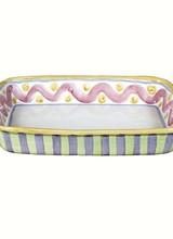 Mackenzie-Childs Fresh as a farm stand peach and fun as country fair fireworks, this is one treat that won't derail your diet—at least until it comes out of the oven! The Piccadilly Baking Dish, hand-painted with sweeping brushstrokes in carnival colors, moves from the ov