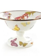 Mackenzie-Childs Here on our Aurora farm, we have a special love of butterflies. On lazy summer days, we delight in seeing them in our perennial gardens and meadows. So it was pure joy to design the colorful flutter of butterflies that graces each piece in this enamelware