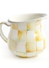 Mackenzie-Childs Color-dragged checks, blending parchment, taupe, gold, and aqua. Some of our serving pieces get a little boisterous with bold, gold spots on an aqua field. Lustred gold rims and accents.