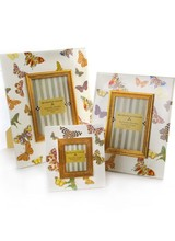 Mackenzie-Childs Frame your special memories in hand decorated enamel, featuring fanciful floating butterflies showing off signature MacKenzie-Childs patterns.
