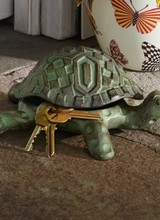 Mackenzie-Childs New! When it comes to stashing the spare, this check-bedecked terrapin is as charming as it is useful. Made of aluminum with a verdigris patina, our Turtle Hide-a-Key is just the right size for tucking covertly among the chrysanthemums. A darling housewar
