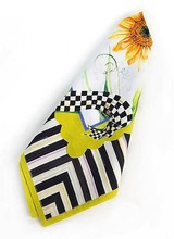 Mackenzie-Childs New! For all the grandeur of the rose, the fragrance of the hyacinth, there's something about the striking graphic simplicity of the sunflower that really stands out. The Sunflower Napkin brings the sunshine of those summer blooms from our garden to your