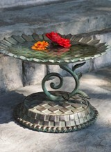 Mackenzie-Childs New! Splish, splash, what a lavish bath! Give the neighborhood songbirds a soak to crow about with our Sunflower Bird Bath. Forged of aluminum and brass with a verdigris patina, this sparrow spa features an oversized rendering of late summer's favorite bl