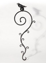Mackenzie-Childs Crafted of wrought iron, this fern-inspired scroll is crowned with a small sparrow to keep your new feathered neighbors company. Little touches like this are what transform a birdhouse into a bird home. And a backyard into a garden refuge.