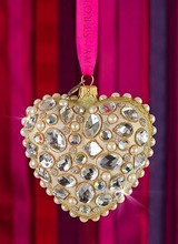 Jay Strongwater This bejeweled heart ornament brings a touch of glamour to your tree with Swarovski crystals and pearl accents. Made of mouth-blown glass, each ornament is handcrafted in Poland and wrapped in a gift box.