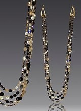 Jay Strongwater Reason to celebrate: In honor of our 20th anniversary, Jay has created beaded necklaces for the first time in over 18 years! Beaded by hand in the New York design studio, they are luxurious mélanges of faceted jet-, bronze-, and champagne-hued glass beads