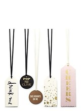Kate Spade our favorite gifting essential? this witty set of wine tags (adorned with &quot;to&quot; and &quot;from&quot; on the back) that will instantly turn any bottle of bubbly into the toast of the town.<br />