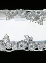 Arthur Court Designs Accent your favorite dish with the full blooms and winged companions displayed in Arthur Court&#039;s Small Butterfly Oblong Tray. <br /> <br /> Attractive butterflies, big and small, fly among brilliantly defined flowers and leaves on the edge of this handmade, aluminum