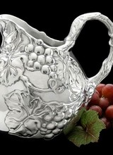 Arthur Court Designs Pour some class into your dinner or drinking party with this Small Grape Pitcher from Arthur Court. <br /> <br /> Bundles of grapes and leaves display beautifully on the piece&#039;s body, while thick, swishing vines fill in these designs and form the handle. The handmade
