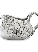 Arthur Court Designs Intrigue your guests with the unique design of this Grape Gravy Boat from Arthur Court. <br /> <br /> Our grape motif displays on each side of this piece as darker lines define each veiny leaf and piece of fruit. Vines also twirl into view on the bottom of this handm