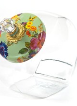 Mackenzie-Childs Greet friends old and new alike with a batch of warm, home-baked treats inside our Cookie Jar with Flower Market Enamel Lid. The glass body offers a preview of the tasty goodness in store, and the lid is color-glazed and hand decorated with fanciful botan