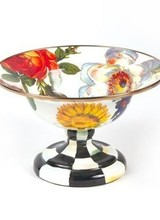 Mackenzie-Childs Color-glazed and decorated with hand-applied fanciful botanical transfers that recall a lush English garden in the peak of summer. Hand-painted Courtly Check® base.