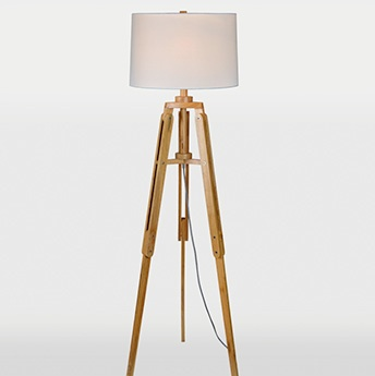 Ren-Wil Tripod-style body features a light wood finish and antique silver metal accents. Off-white cotton shade.