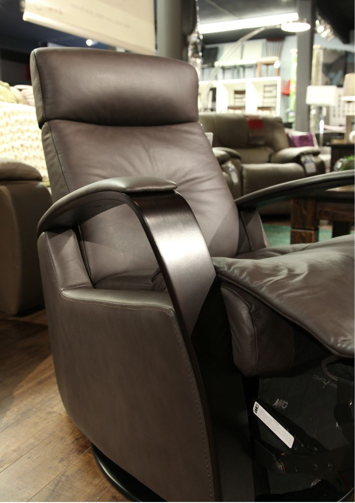IMG Avant Glider Recliner.  Stocked  in T406 Chocolate Leather with Adjustable Headrest & Arms in Espresso.