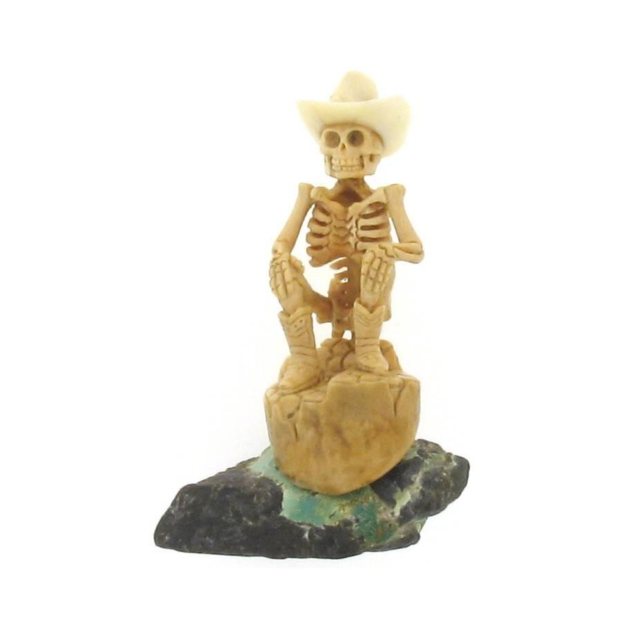 Artifactual Carved Cowboy Skeleton on Turquoise