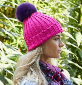 Funky hand-knit hats with interchangeable fur poms!