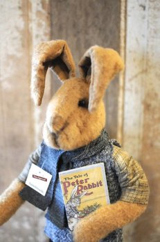 Rabbit Holding Book with Black Pants & Grey Sweater