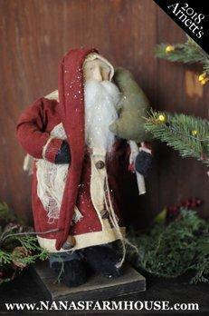 Arnett's JC18 Arnett's Santa in Red Coat Holding Tree