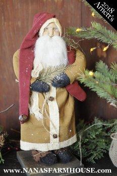 Arnett's JC16 Arnett's Santa in Mustard Coat with Red Stocking