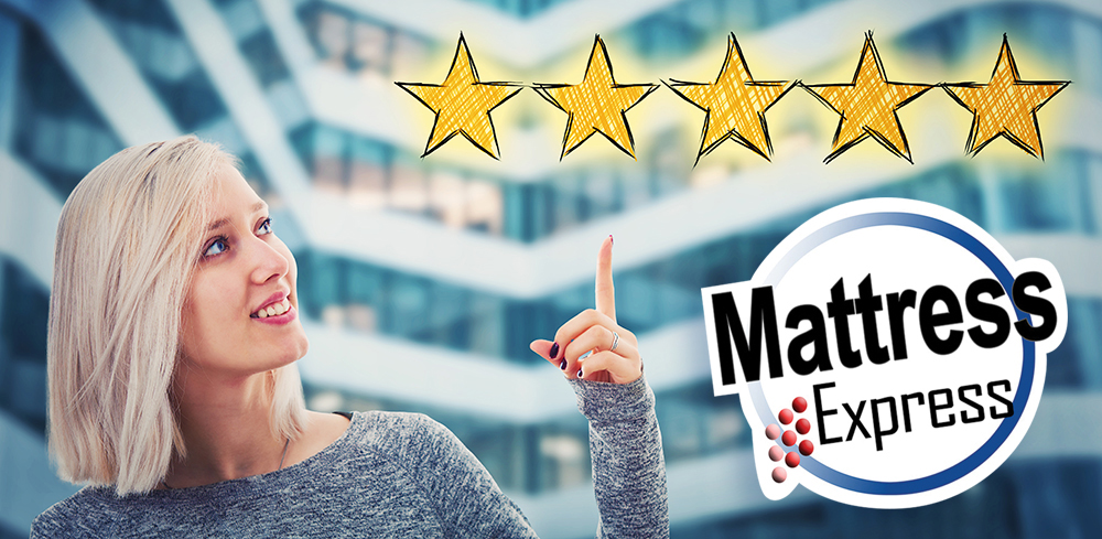 Female customer with blond hair giving mattress express a five star rating