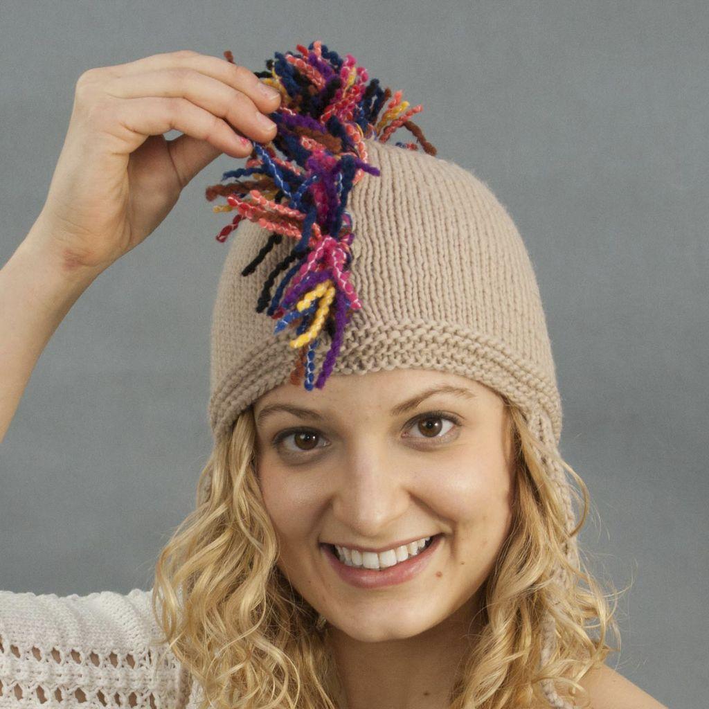 The Sweater Venture Fringe Top Flap Cap