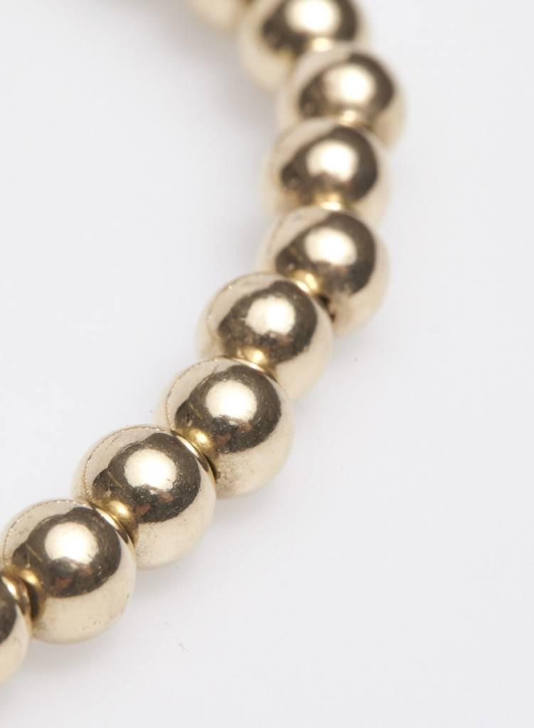 Agatha Bracelet élastique petites billes dorées