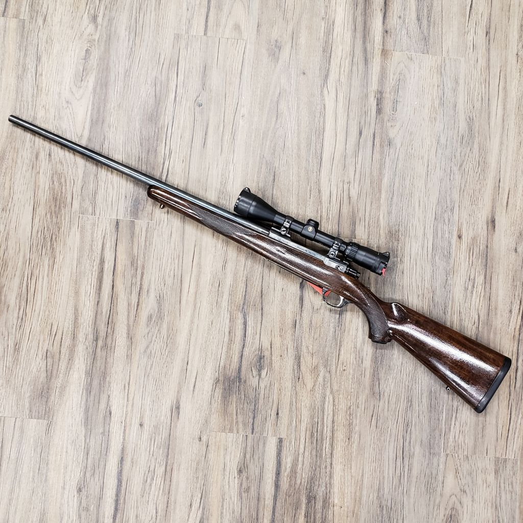 RUGER RUGER M-77 RIFLE, 300 WIN MAG, WOOD STOCK, W/ SCOPE, PRE-OWNED