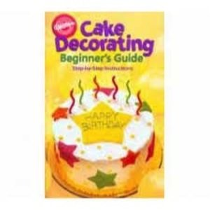 Wilton Products . WIL BOOK CAKE DECORATING GUIDE