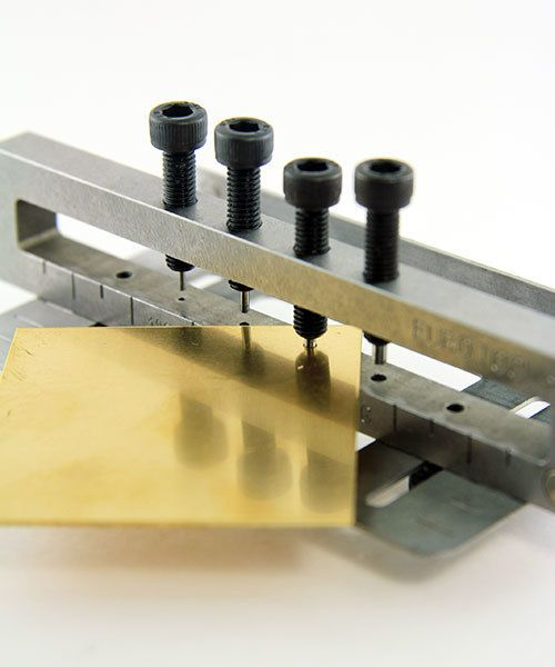 PN4204 = 4 Hole Metal Punch by Eugenia Chan