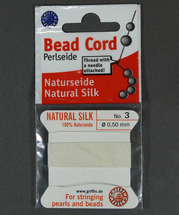 38.01203 = White Silk Beading Cord #3 on Card with Needle