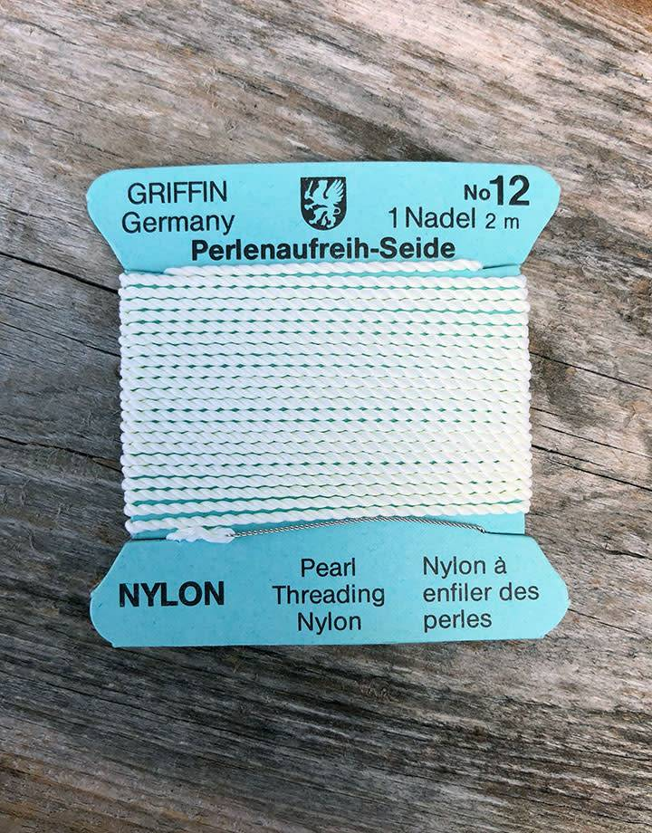 38.0832 = White Nylon Beading Cord #12 on Card with Needle