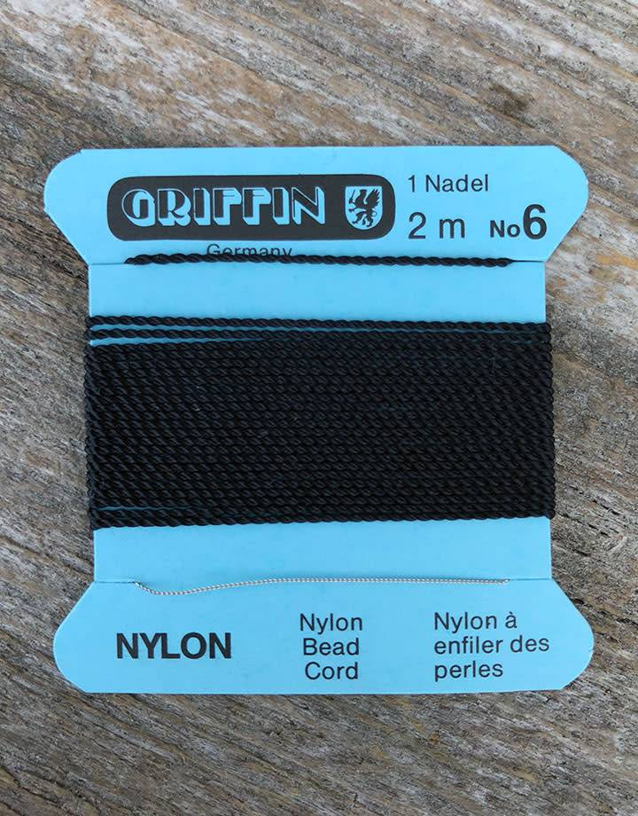 38.0706 = Black Nylon Beading Cord #6 on Card with Needle