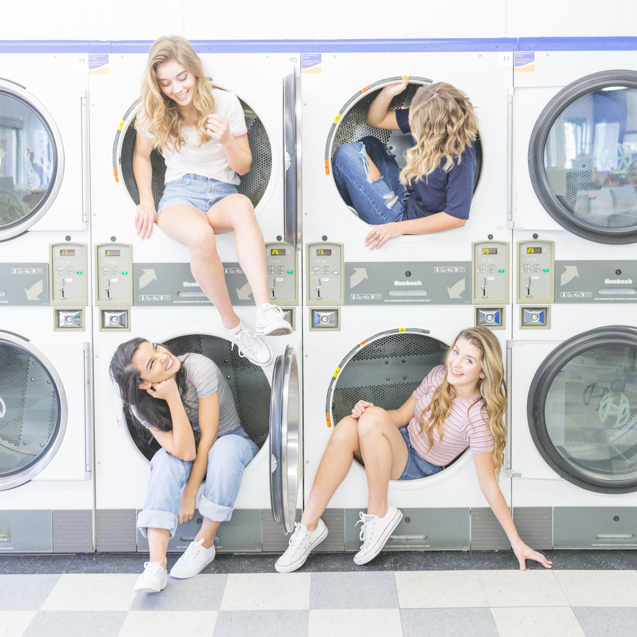 Group of girls at a laundry mat