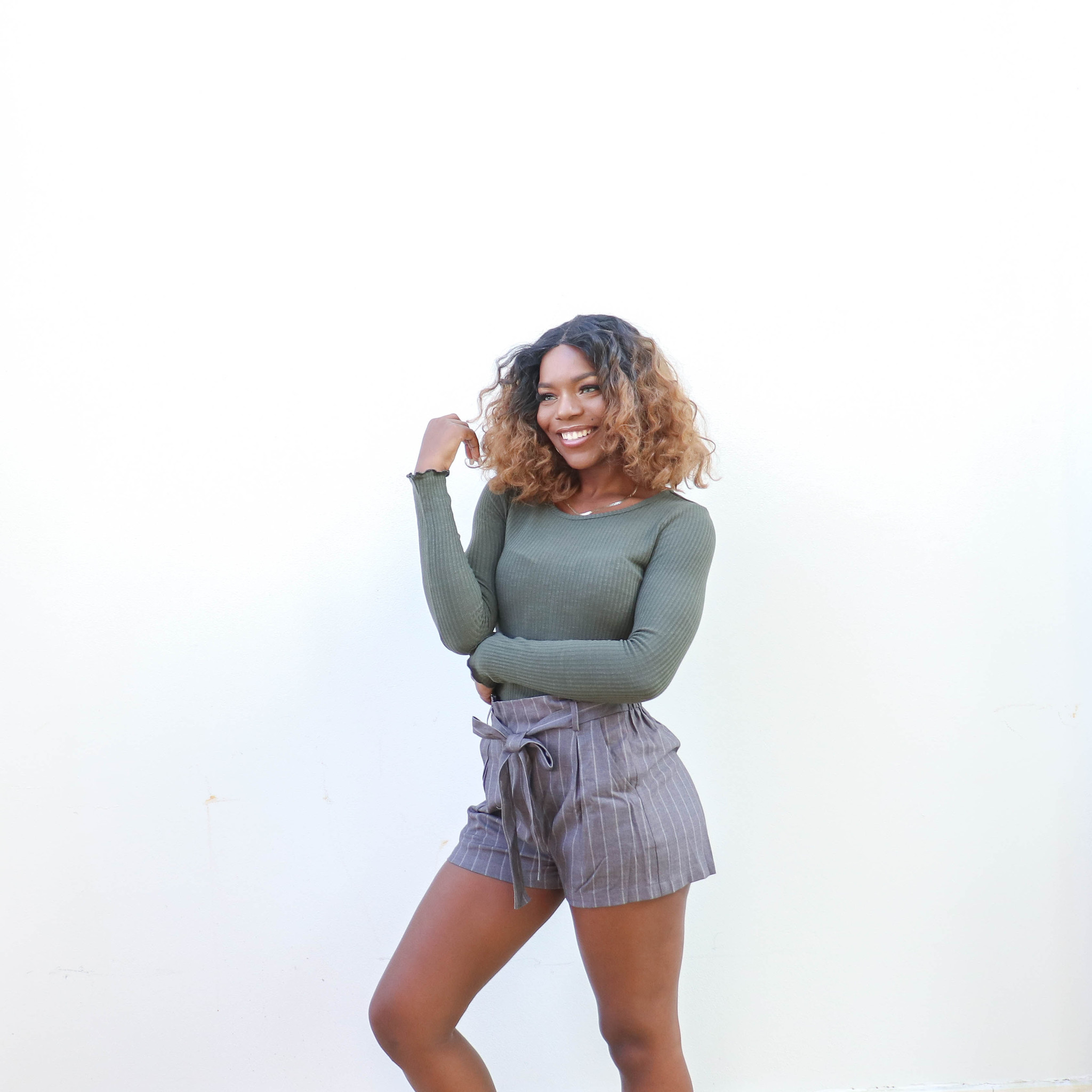 shows a model featuring Striped Bow Shorts in grey with white stripes